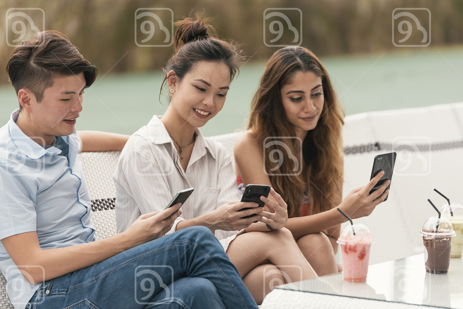 Asian friends browsing their mobile phone