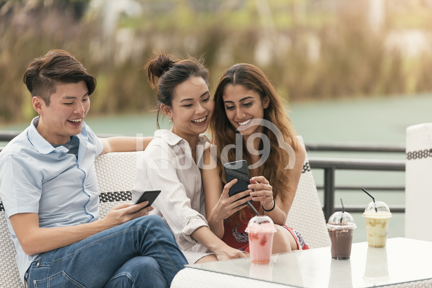 Happy friends browsing their smartphone