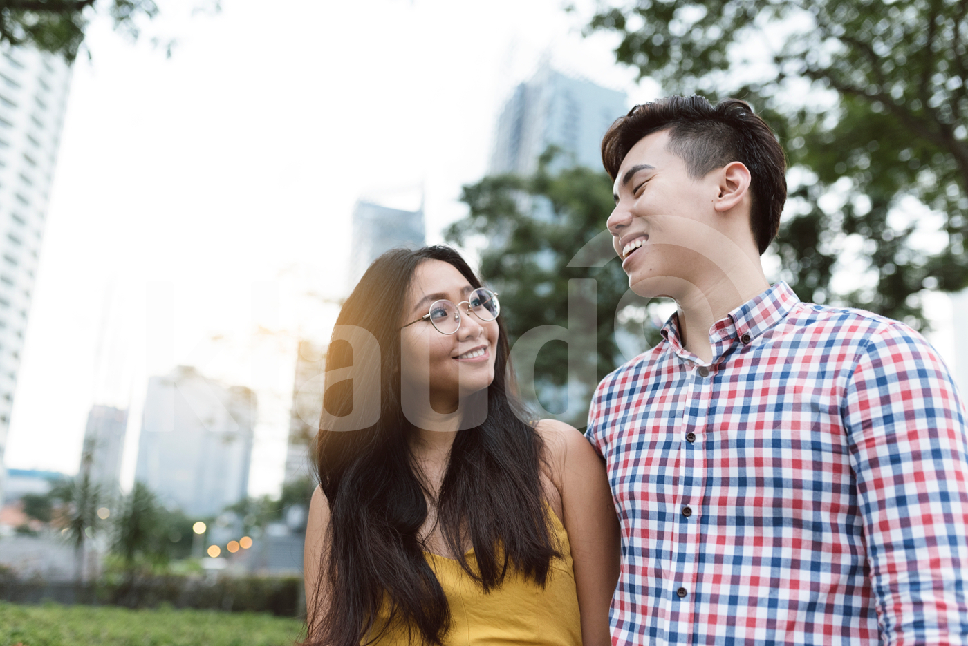 Happy Chinese couple walking in the city