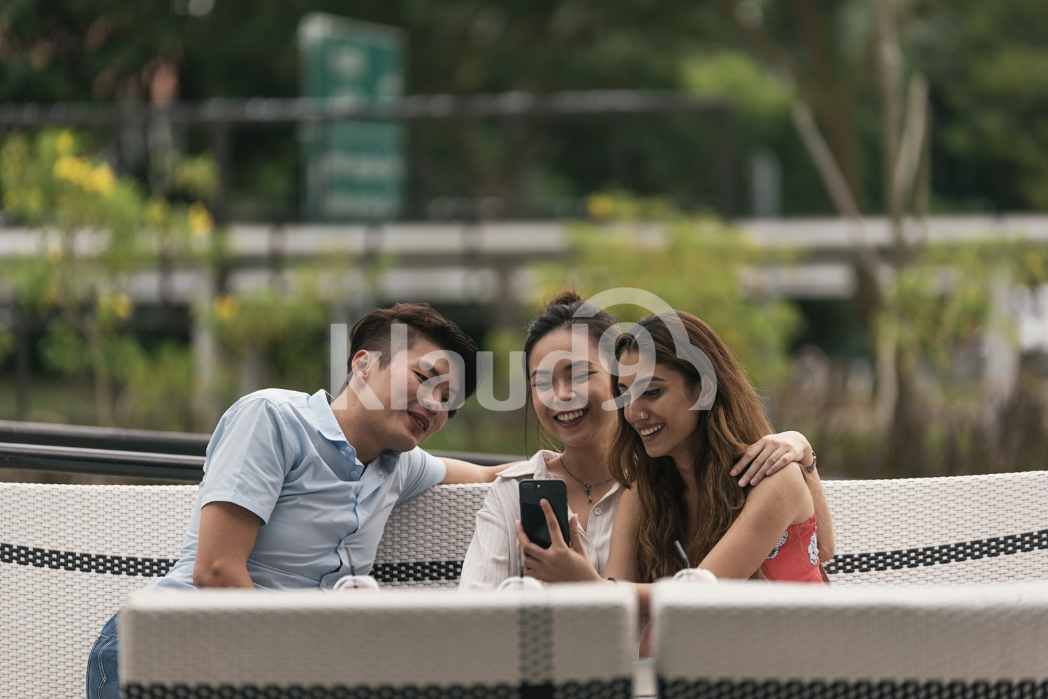 Group of Asian friends watching video on smartphone