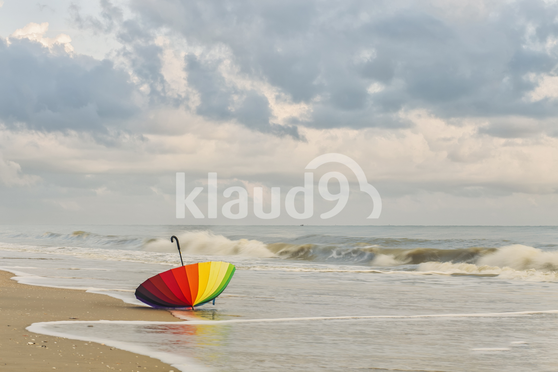 Rainbow umbrella by the beach
