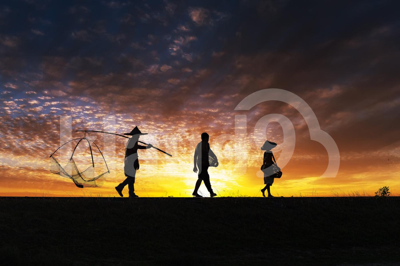 Men walking at sunset