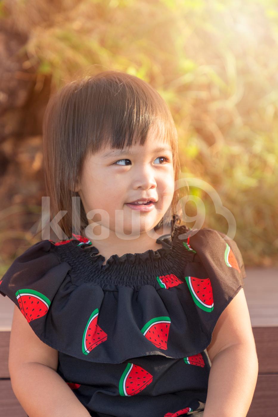 Happy little girl enjoying outdoors