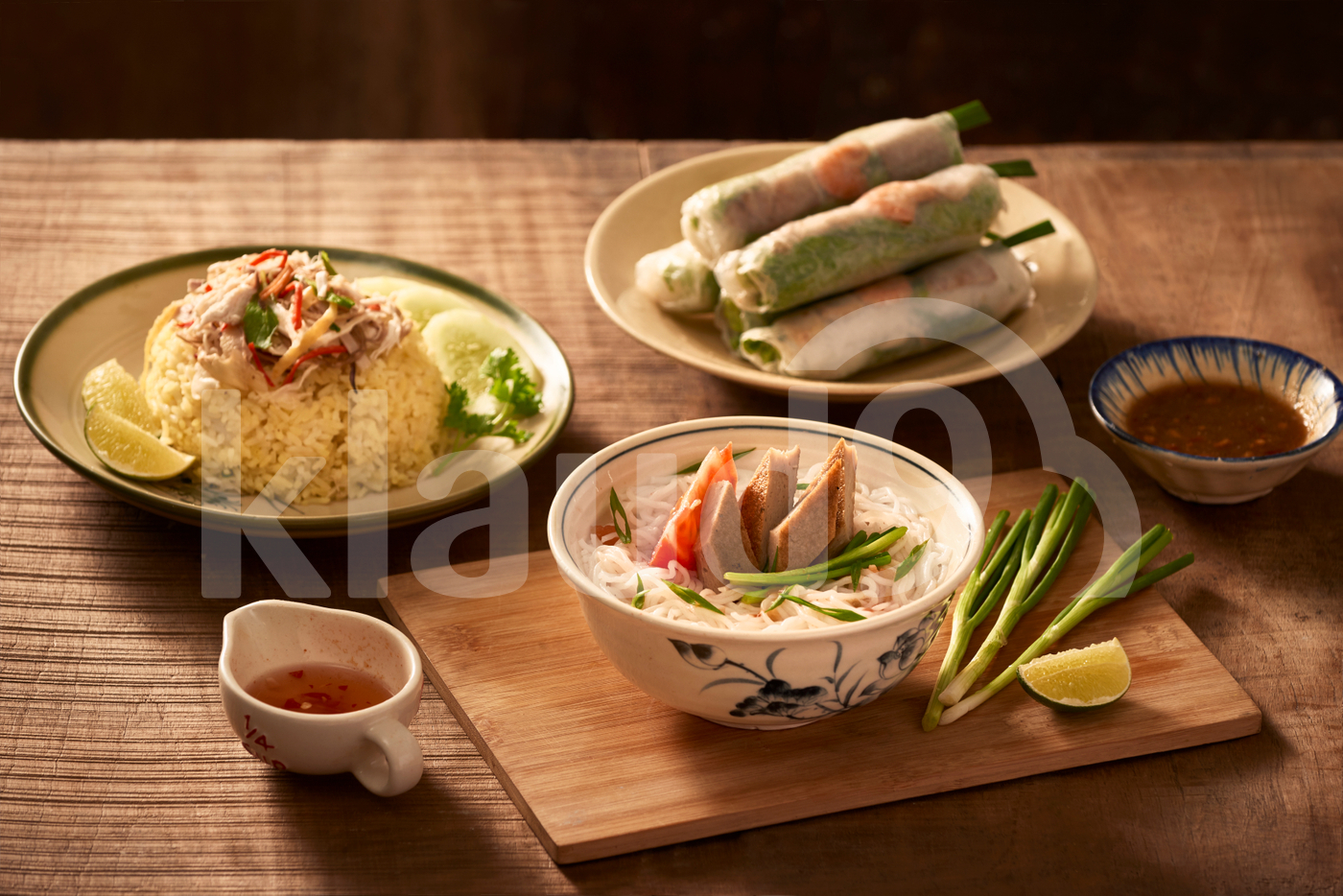 Assorted asian dinner, vietnamese food. Chicken rice, bun cha ca, noodles, spring rolls