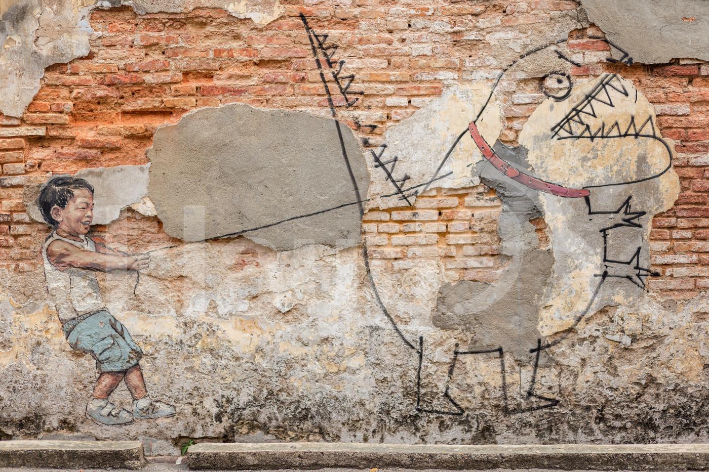 Boy pulling his pet dinosaur street art
