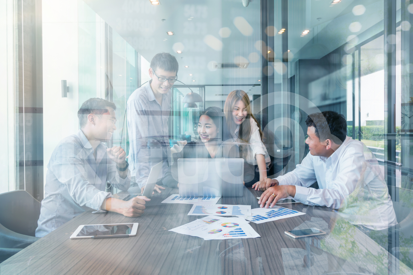 Group Of Asian and Multi ethnic Business people with casual suit working and brainstorming together with technology computer in the modern Office, people business group and entrepreneurship concept.