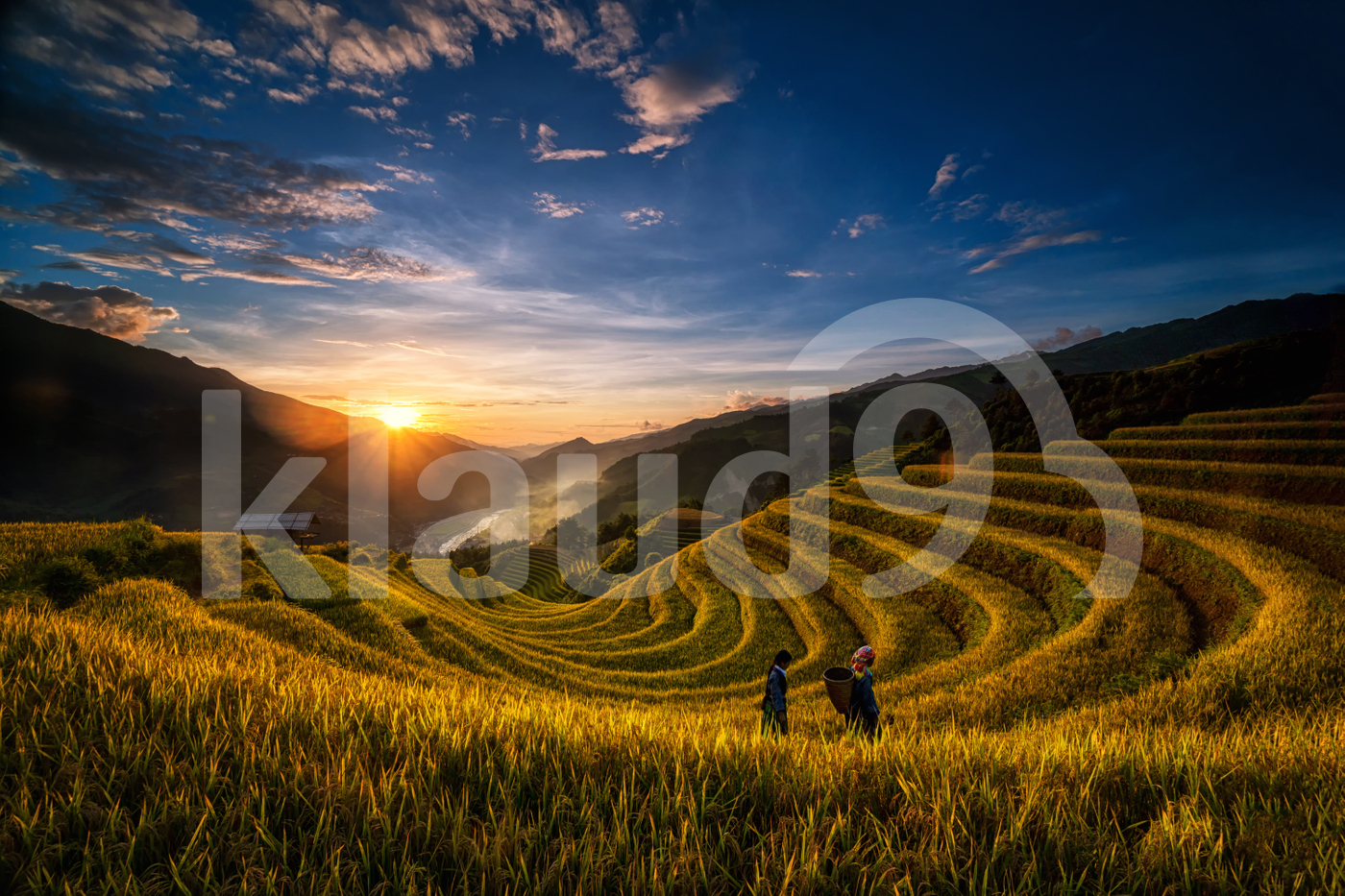 Two undefined Vietnamese Hmong are walking in the fantastic landscape of rice field terrace.