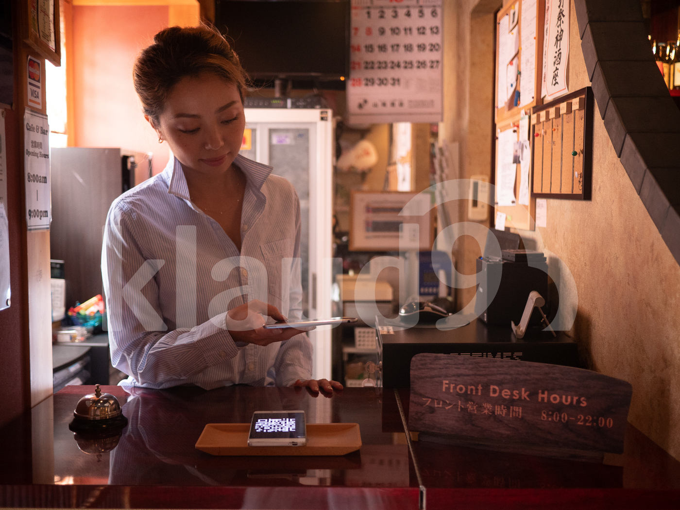 Asian woman scanning with QR code with tablet