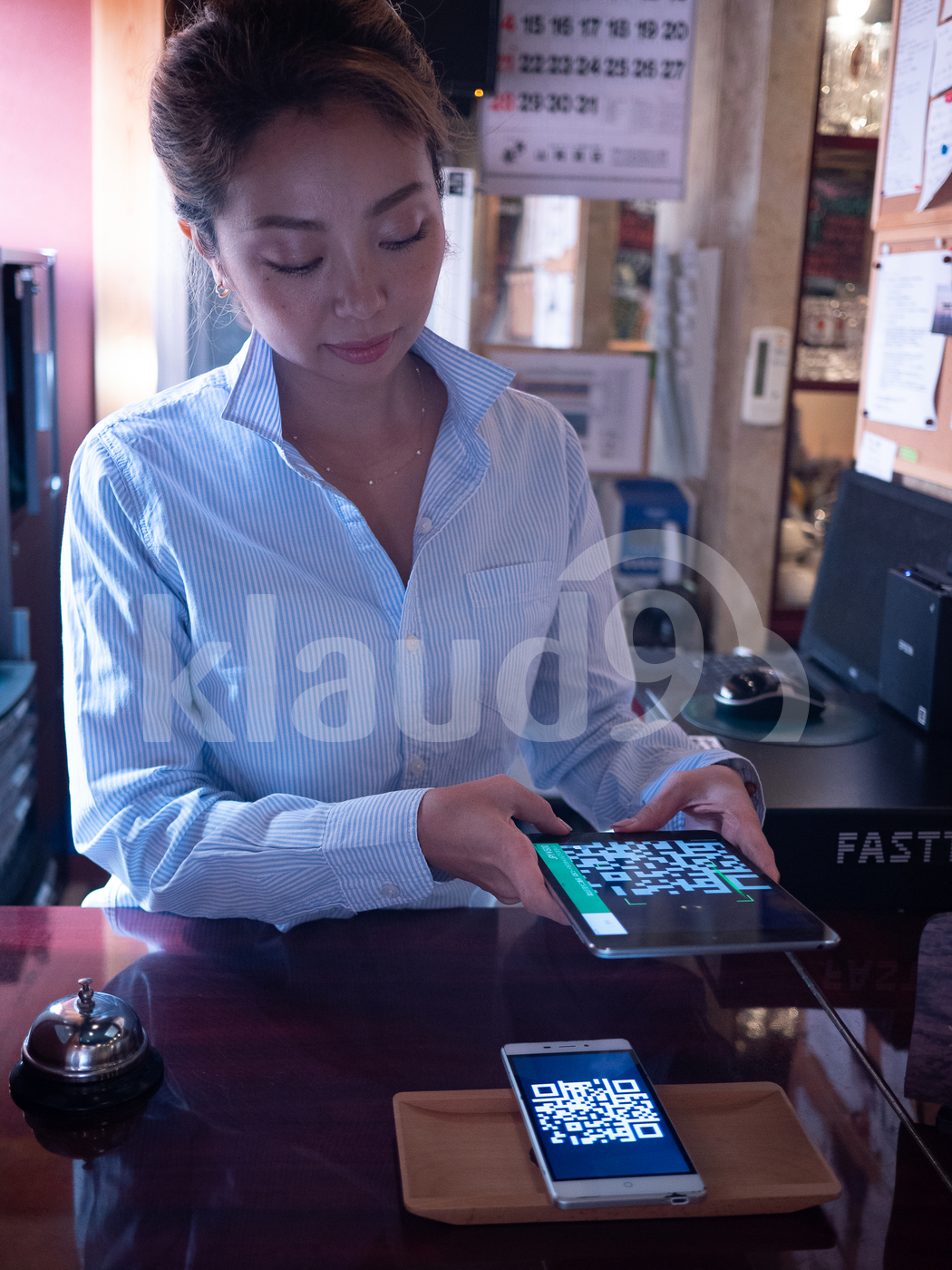 Woman scanning with QR code with tablet