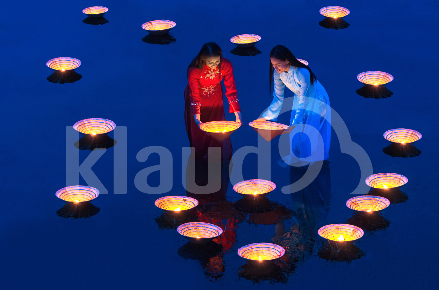 Two Asian beautiful woman putting the Vietnam Hats over the lake at evening twilight time, Countryside Lifestyle concept