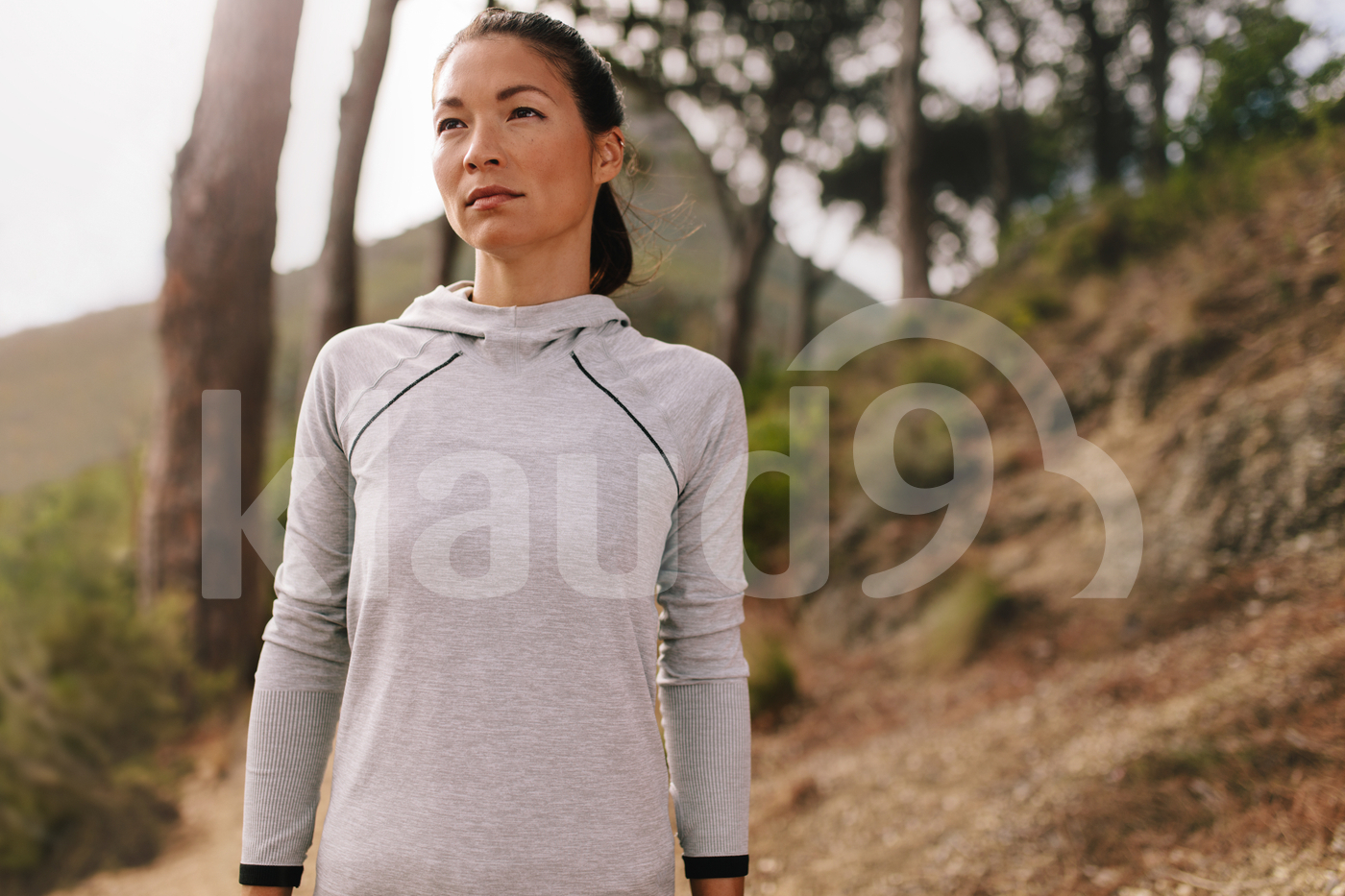 Fit woman runner outdoors on country road