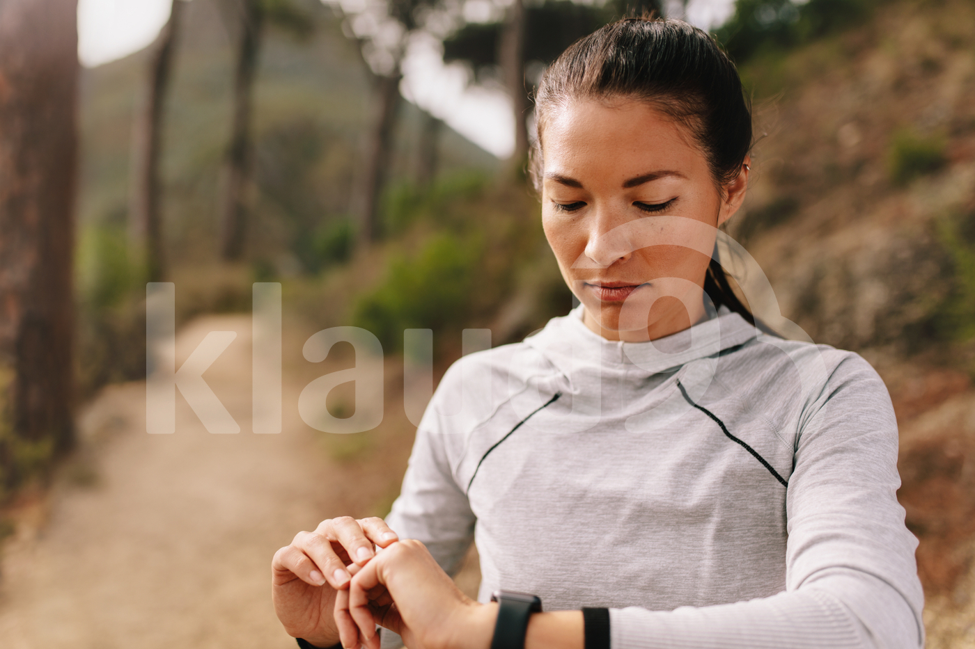 Female checking fitness progress on her smart watch