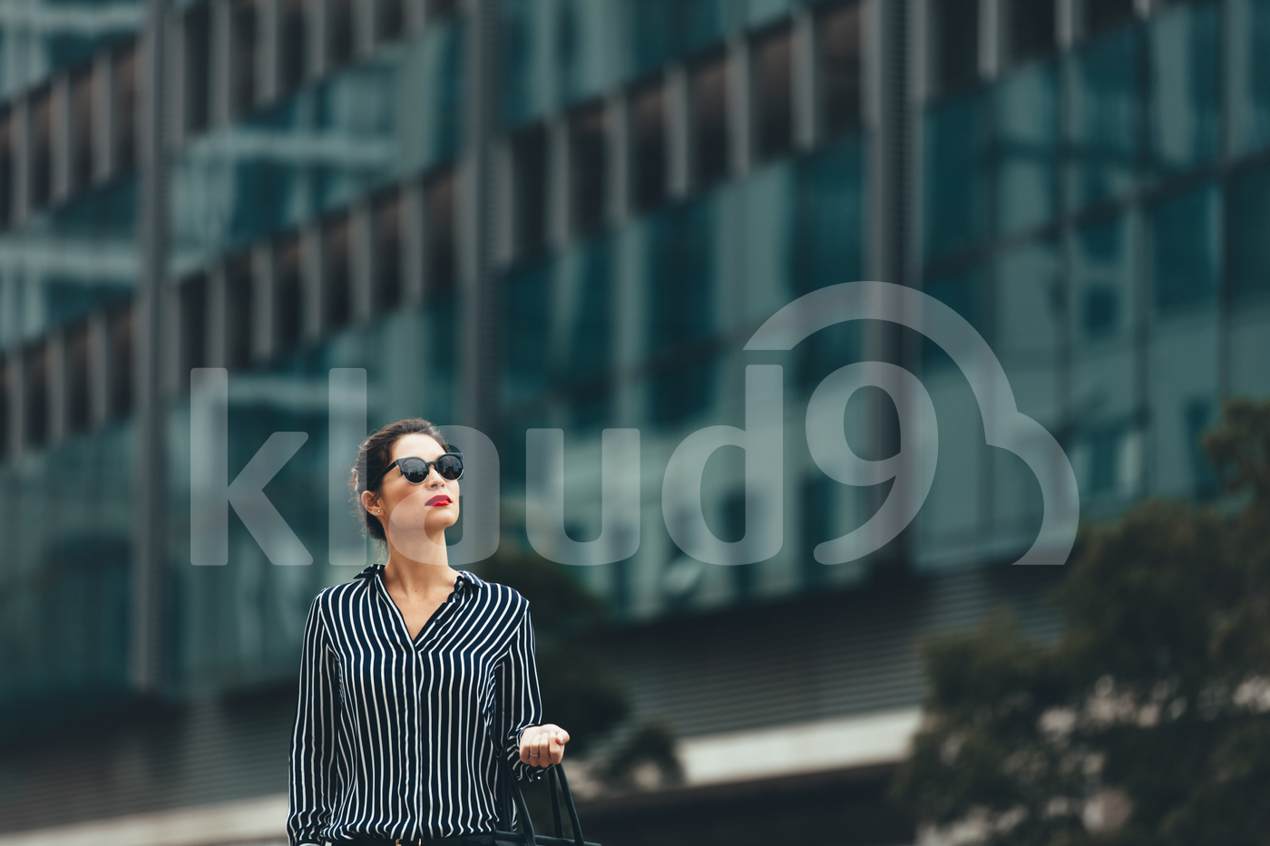 Female business professional outside an office building