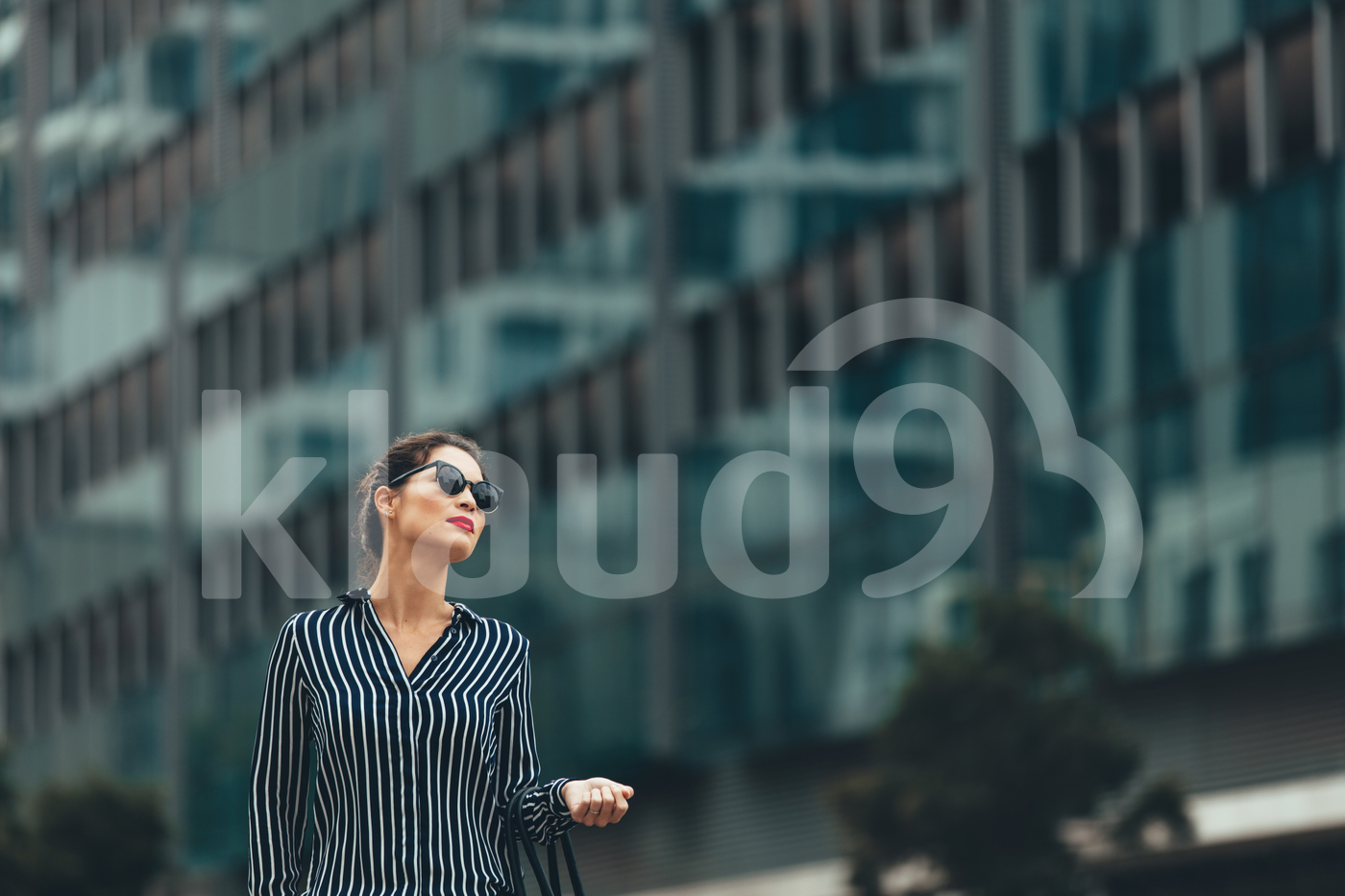Business woman in front of urban building