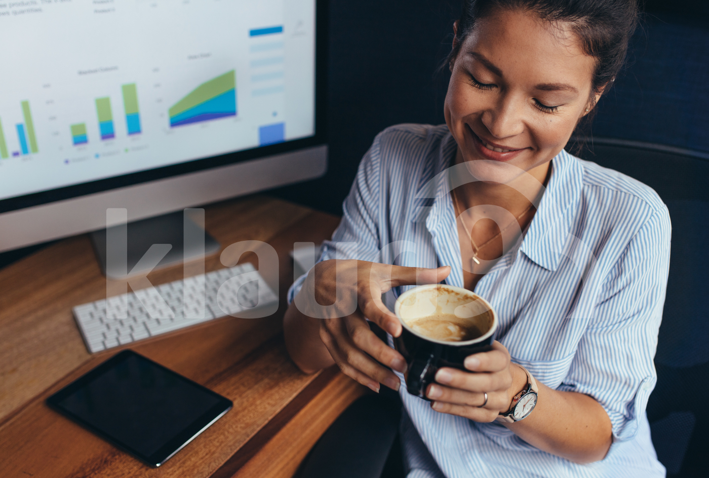 Businesswoman having coffee break in office