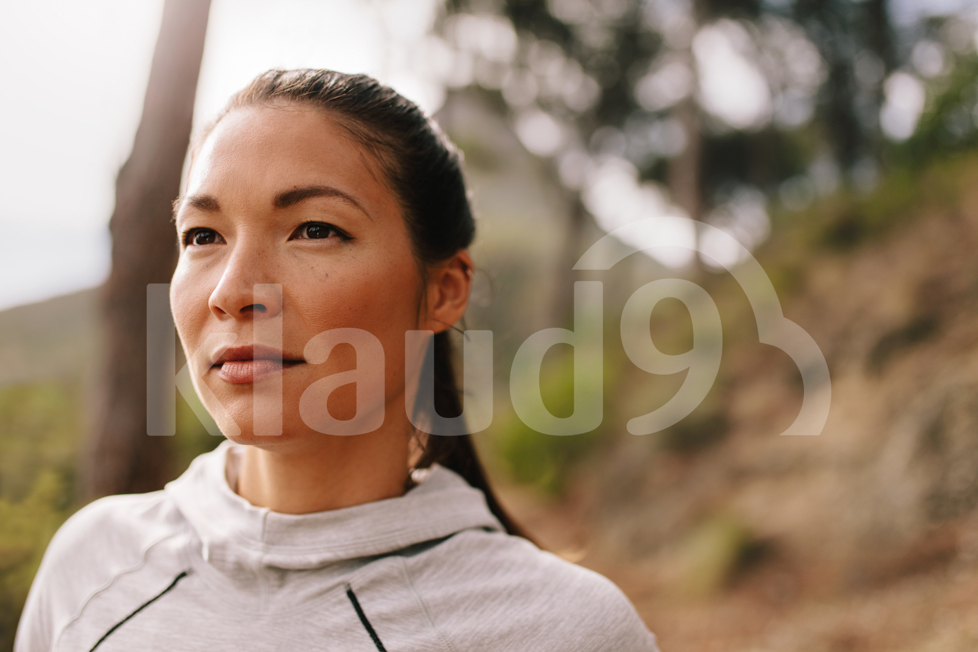 Young woman runner looking away