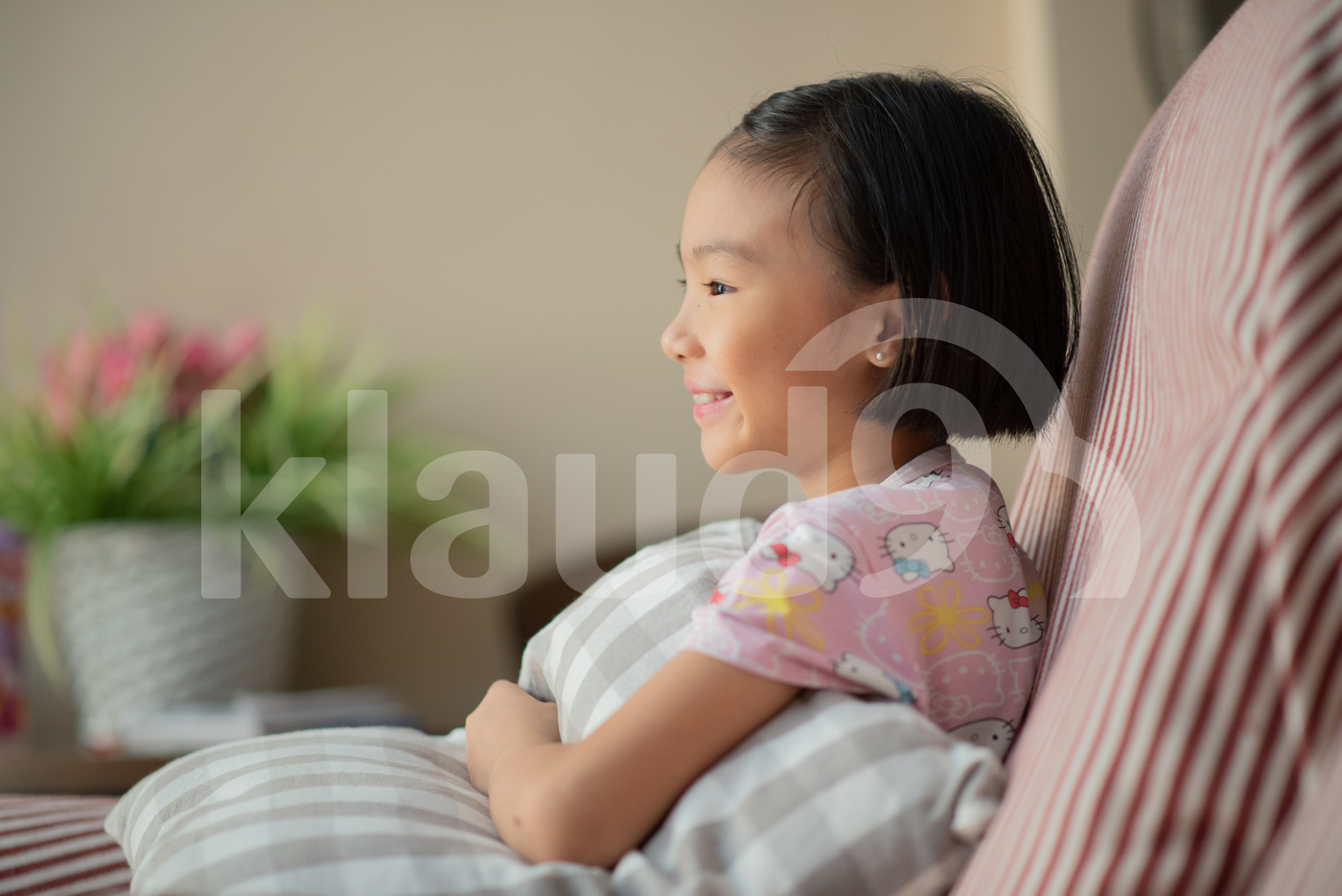 Asian child at home during lockdown, watching TV
