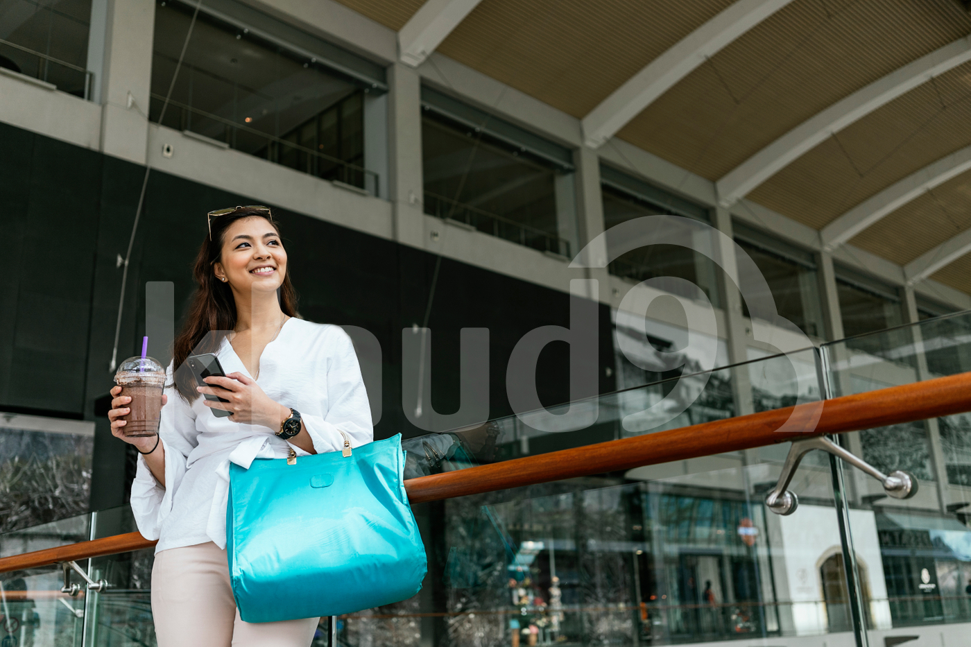 Young Asian woman standing in the mall