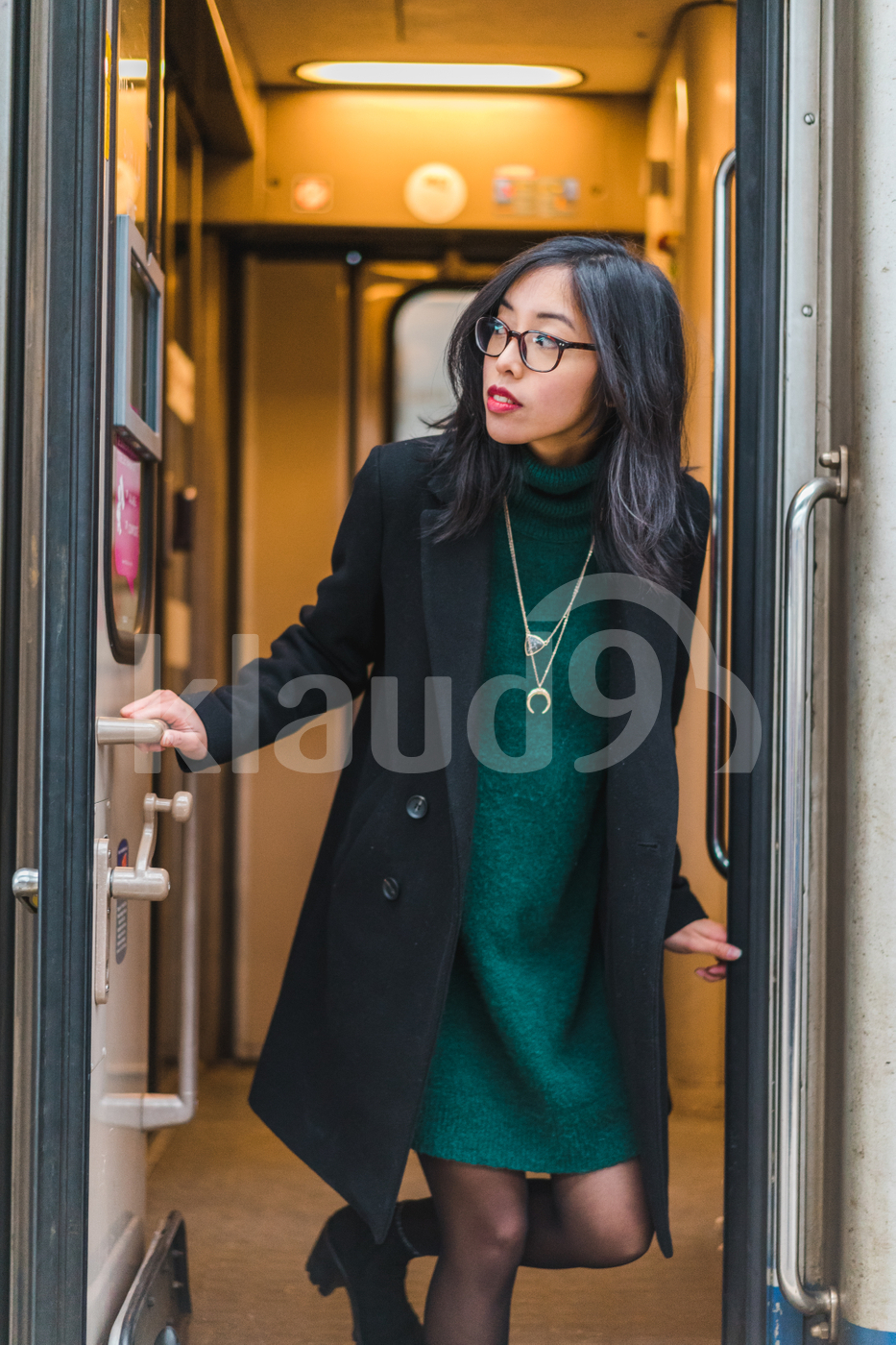Asian woman leaving a train