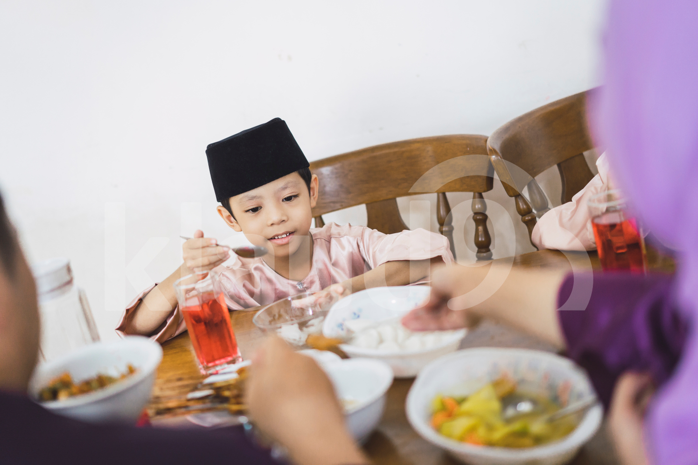 Muslim family enjoying dinner