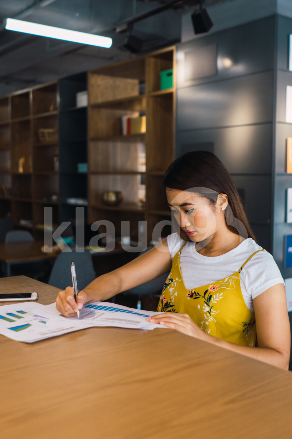 Asian woman sitting in the office
