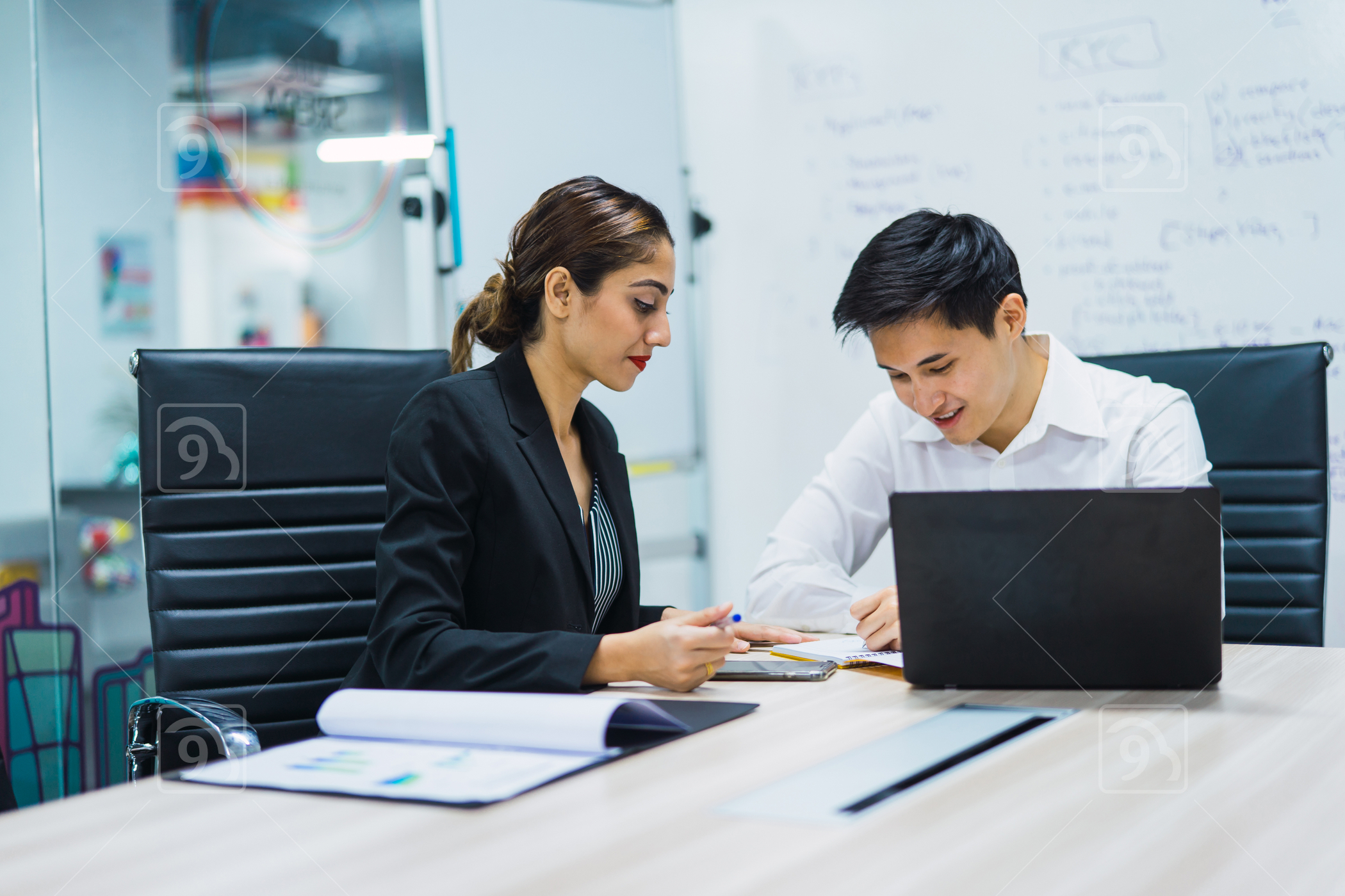 Asian coworkers meeting in a co-working space