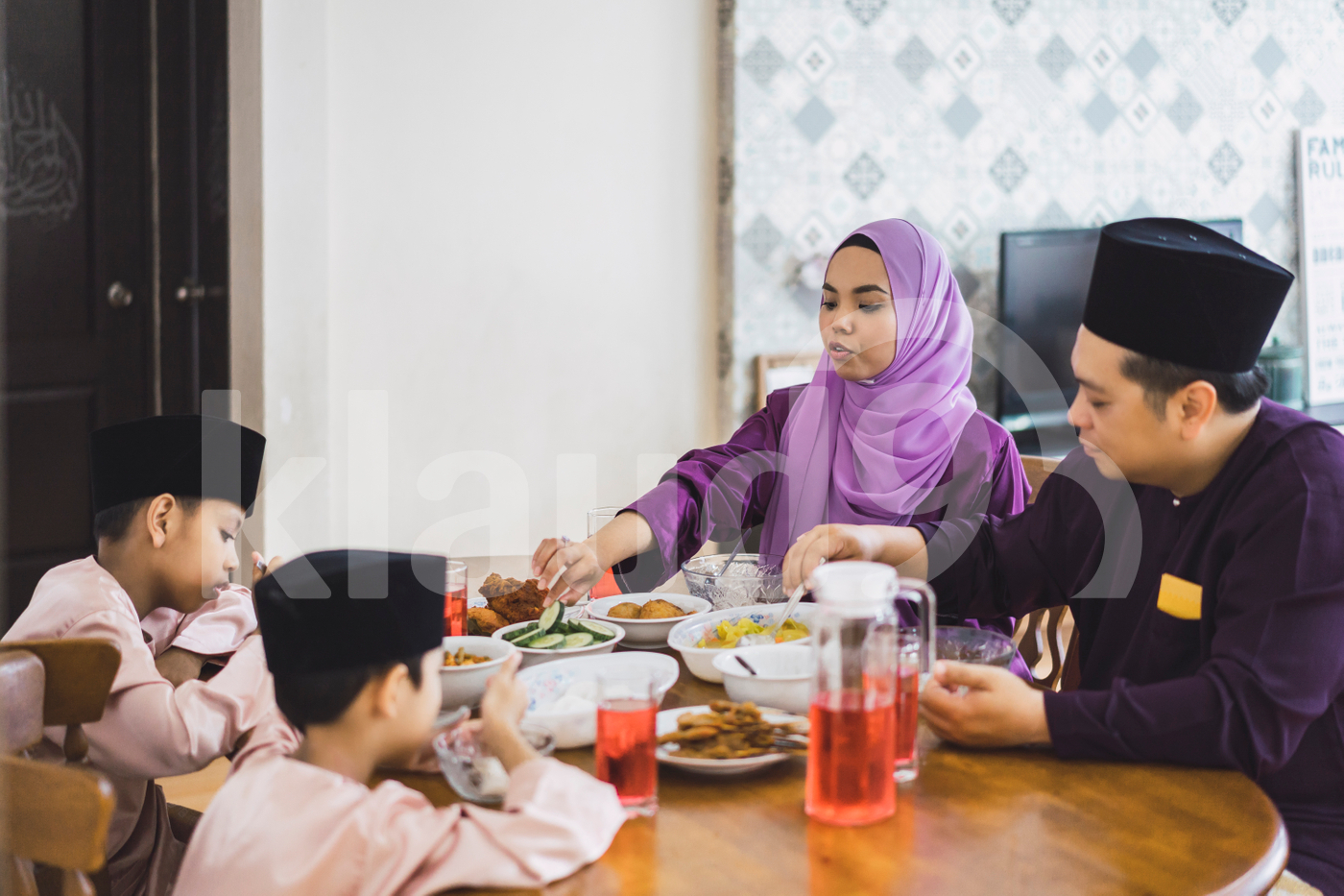 Muslim Family having food at home