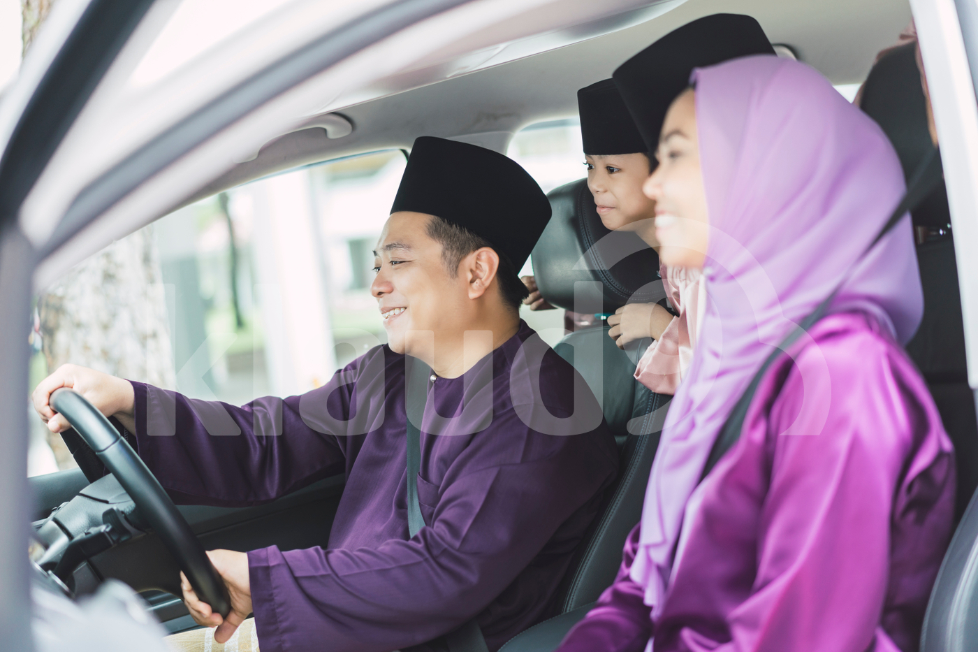 Muslim family driving in a car