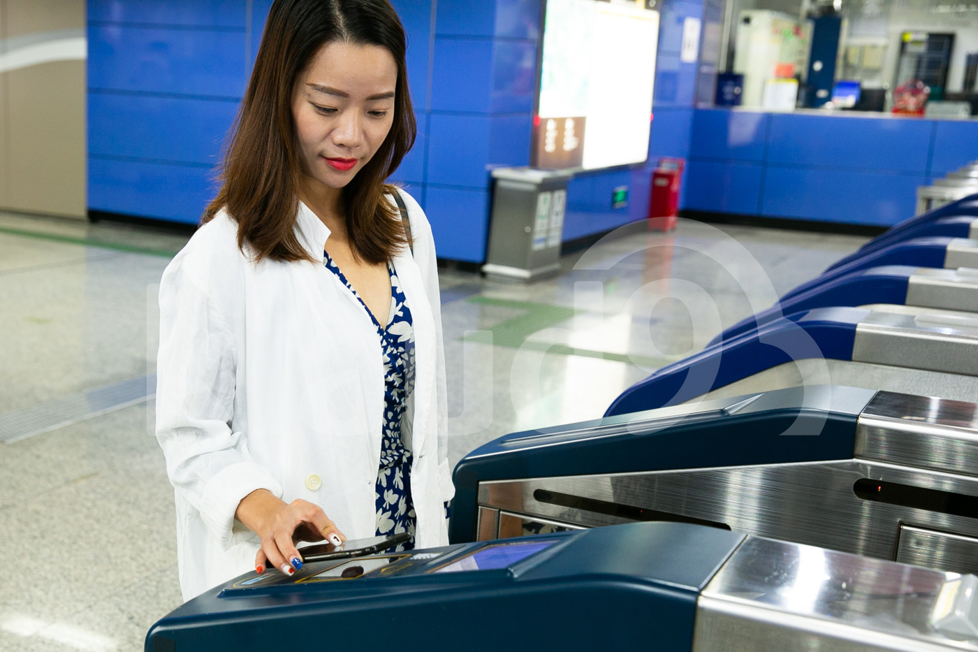 Asian Woman using smartphone to pay public transport