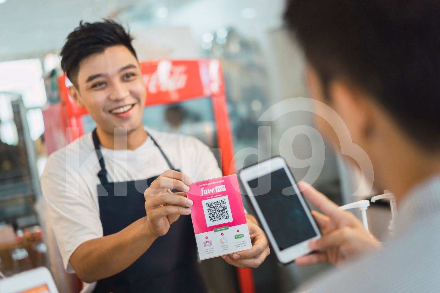 Asian man making payment with mobile