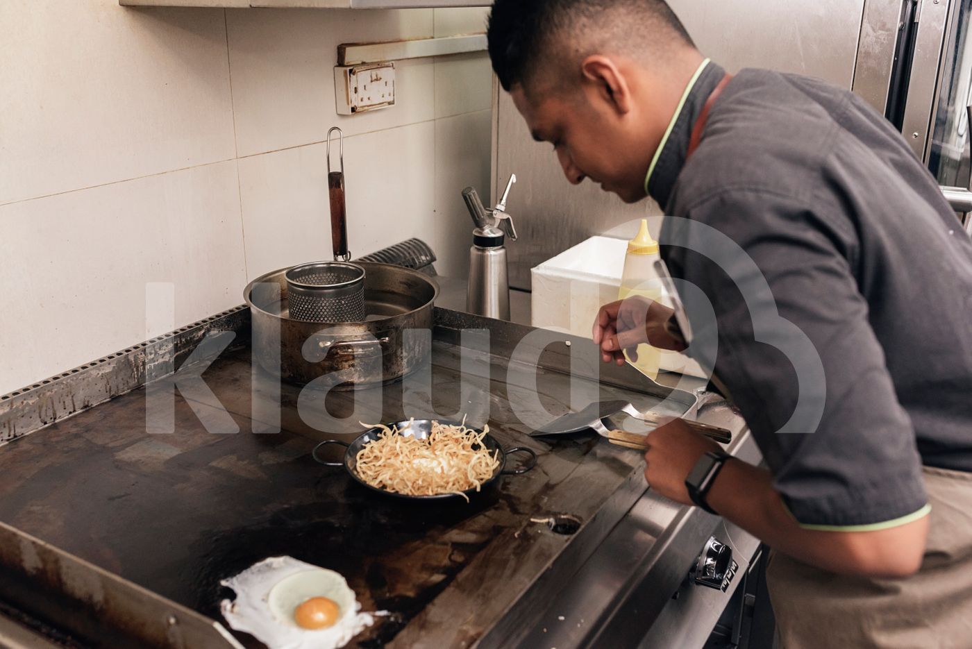 Asian chef preparing food in the restaurant kitchen