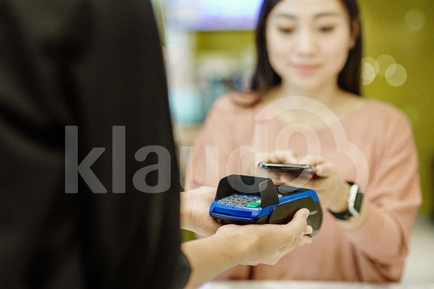 Asian woman  at restaurant making e-wallet payment