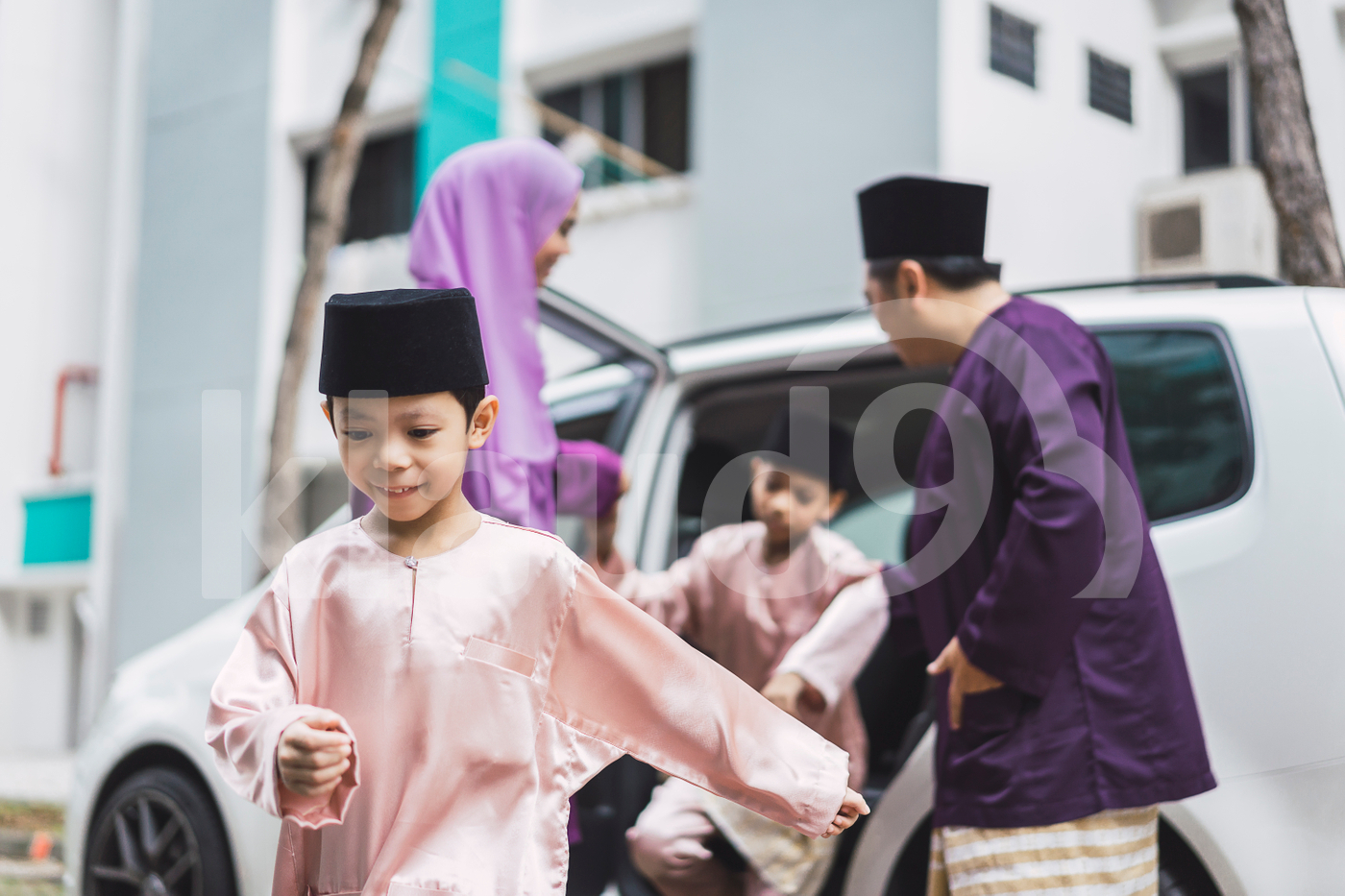 Malay family getting out of the car