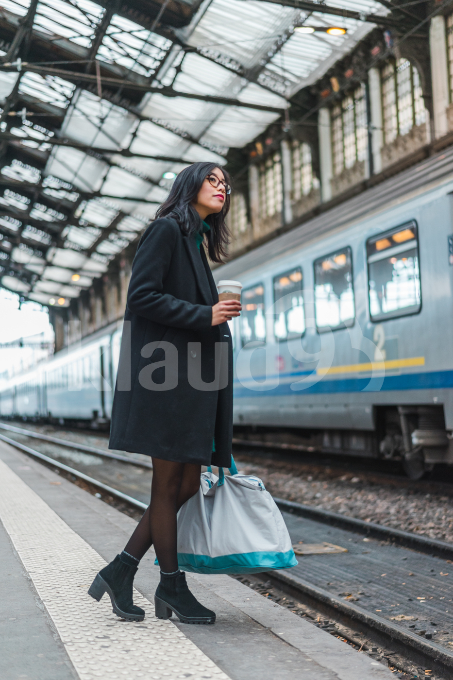 Asian woman waiting for a train
