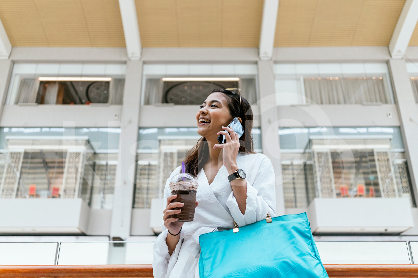 Woman standing in the mall, talking on the phone