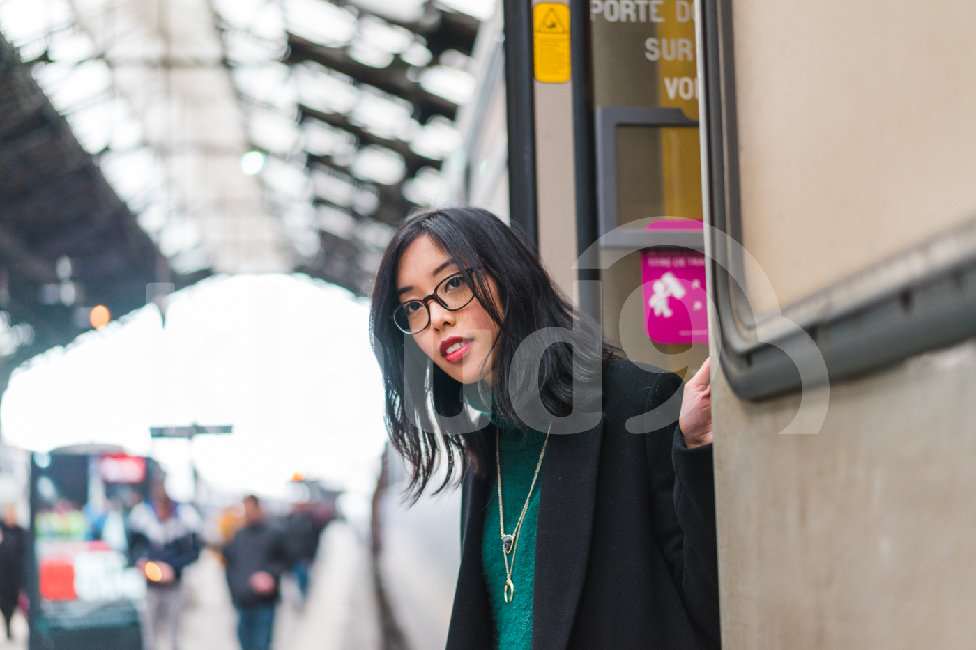 Young Asian woman stepping off a train
