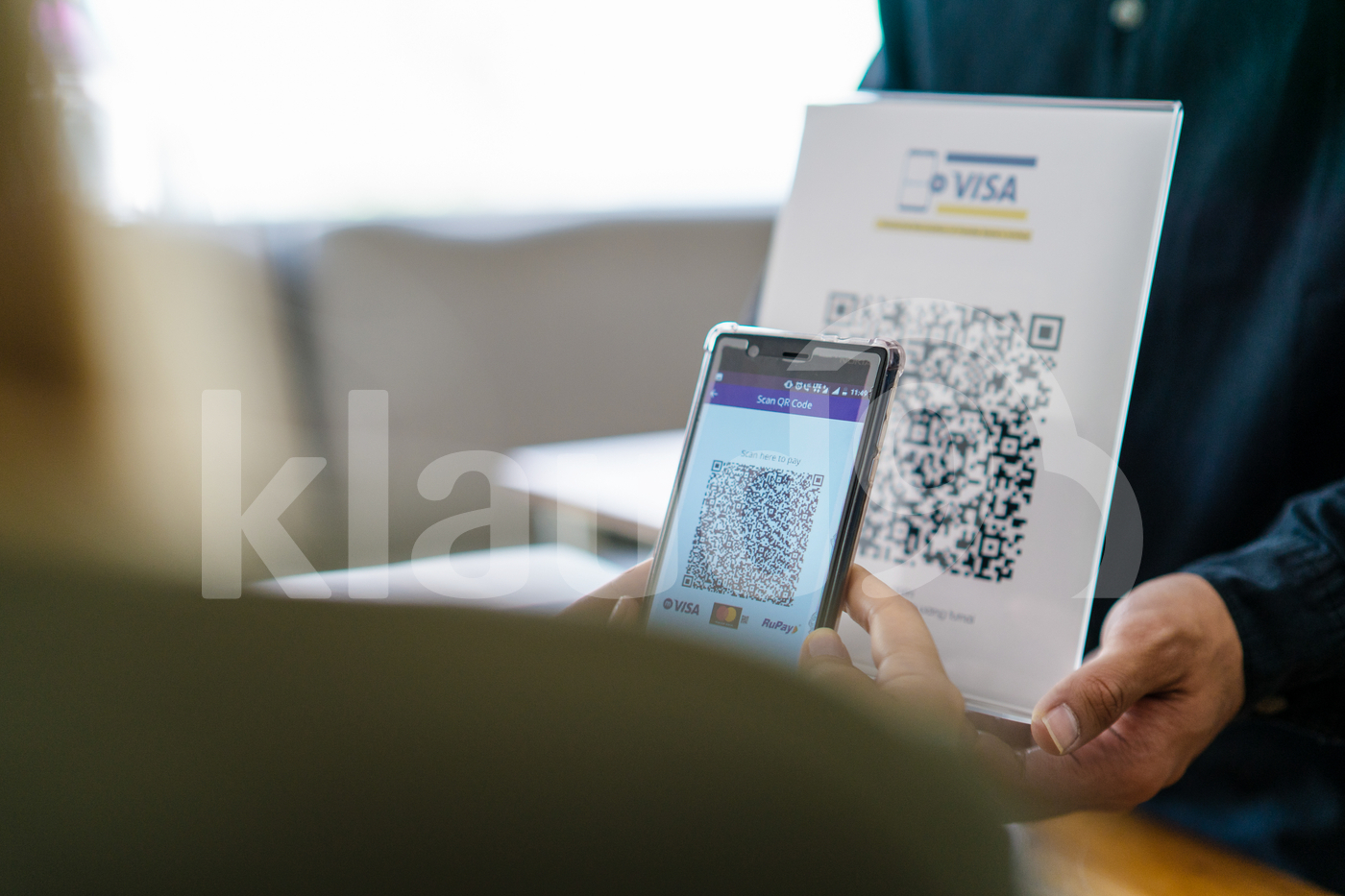 Young Asian woman making payment scanning QR code