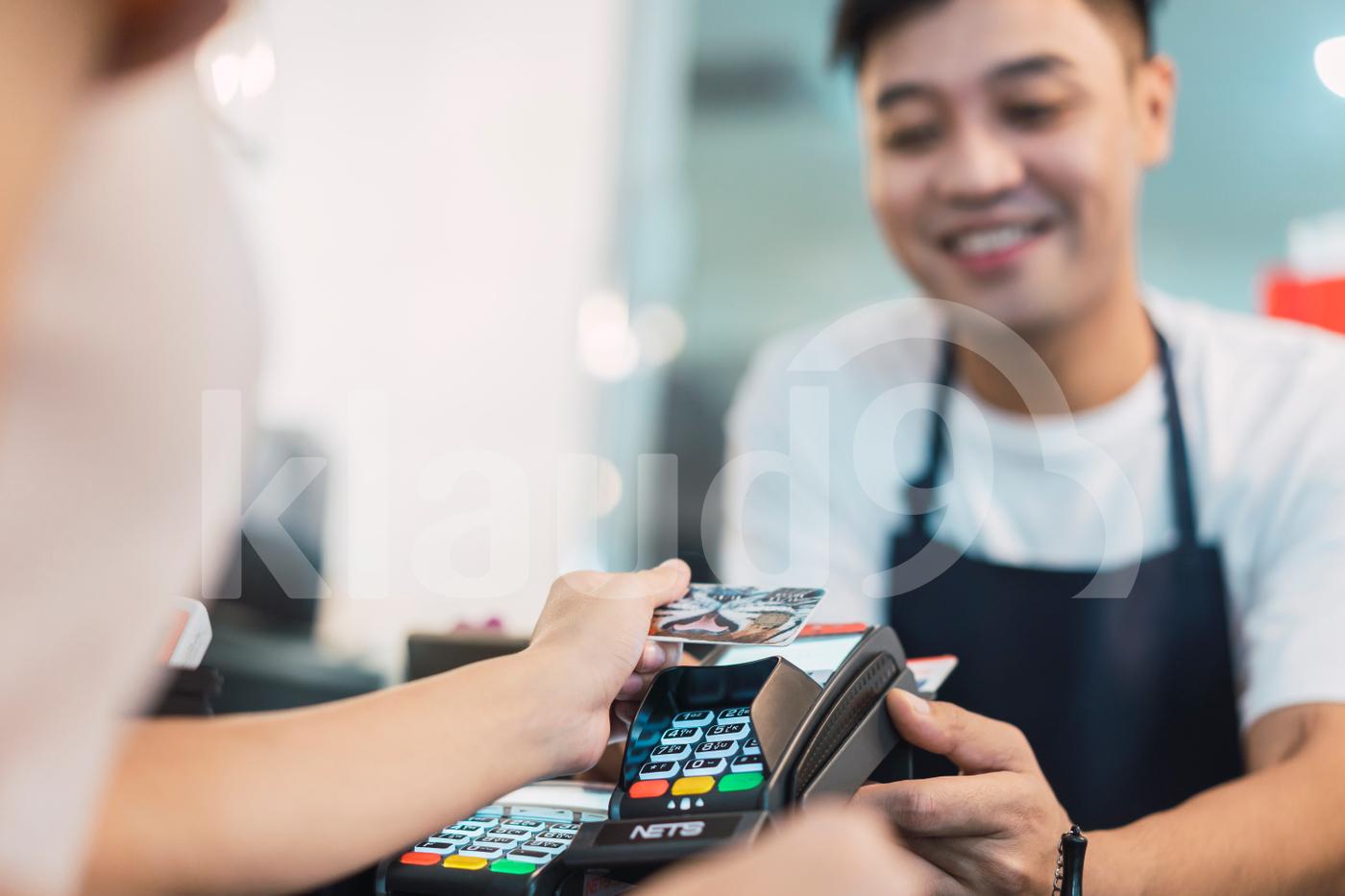 Woman paying bill throug  e-wallet