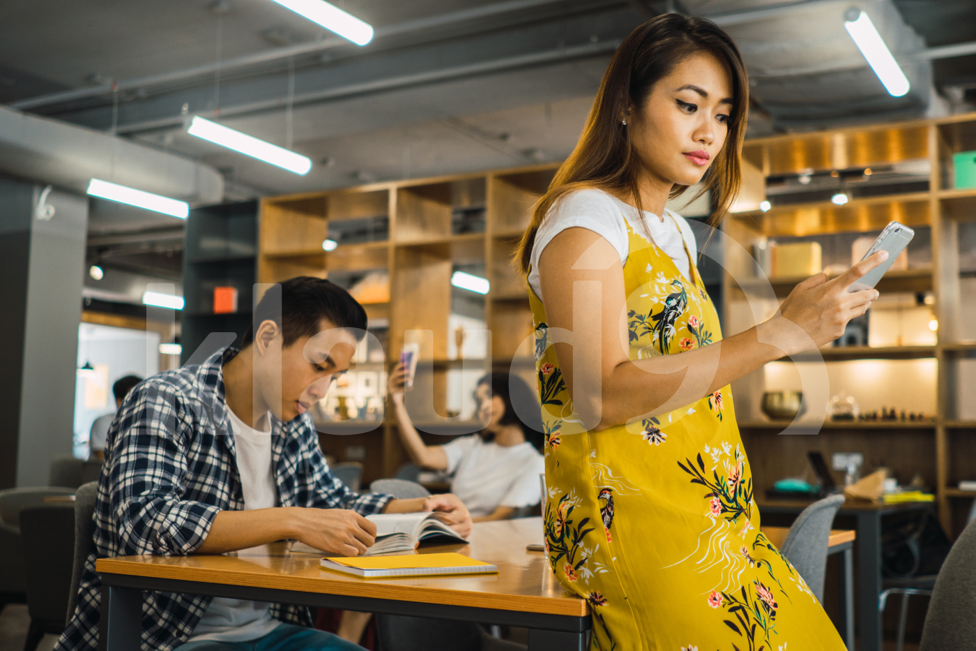 Asian millennials working in a co-working space
