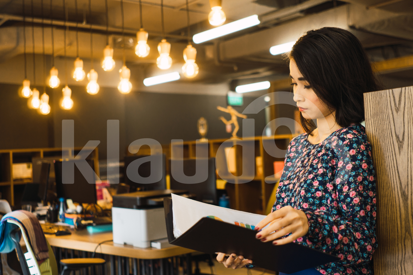 Asian woman standing in the office