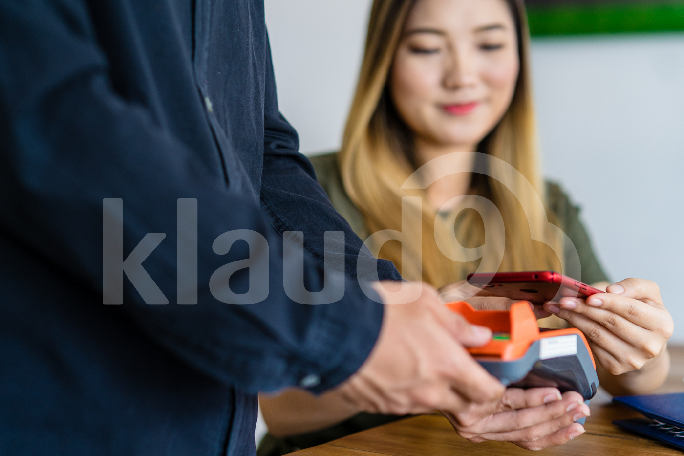 Woman making payment with mobile