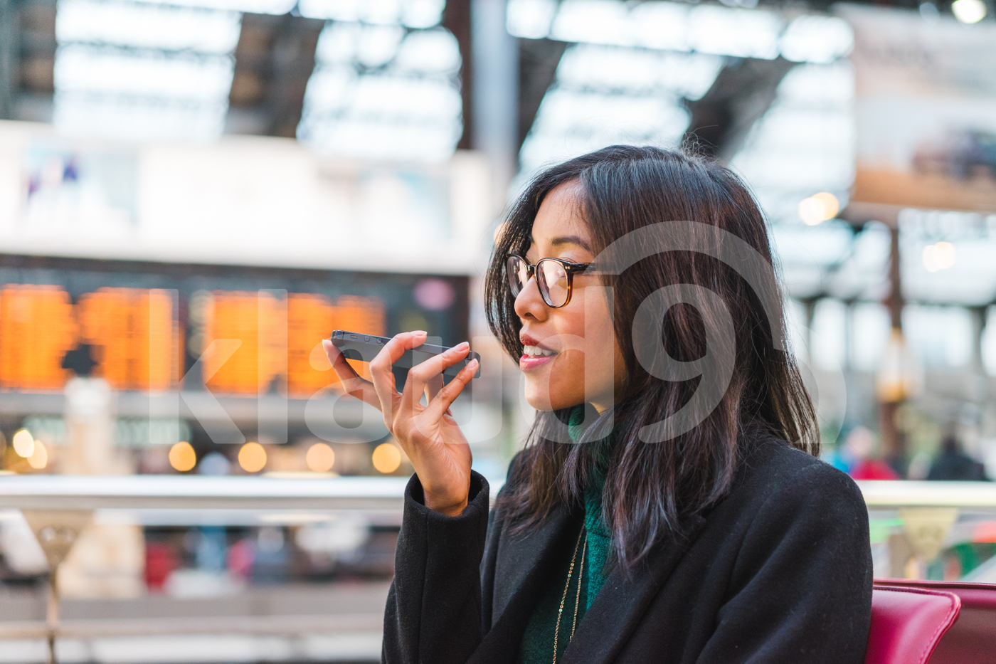 Young adult Asian woman talking on her mobile