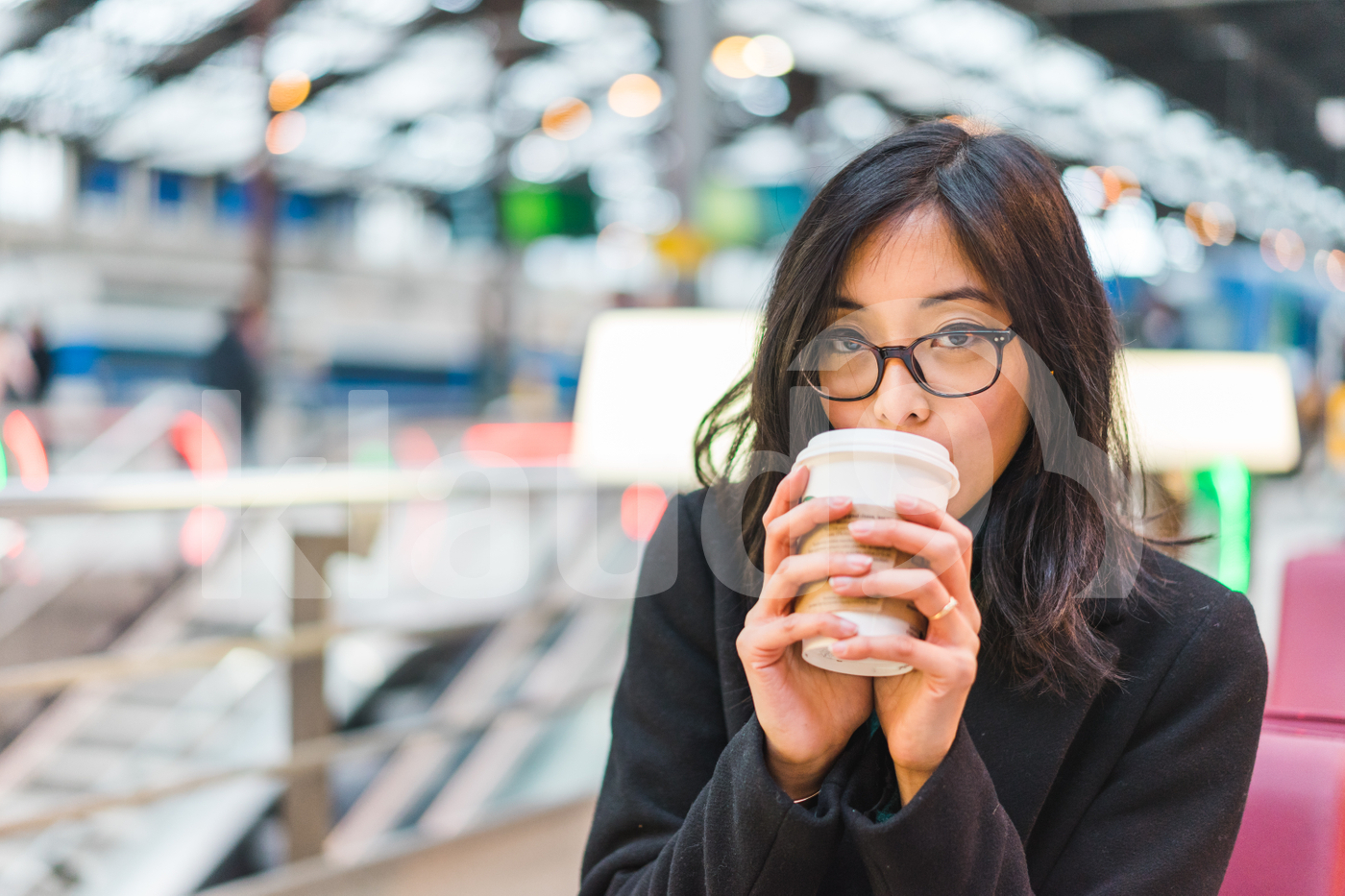 Young Asian woman drinking a coffee