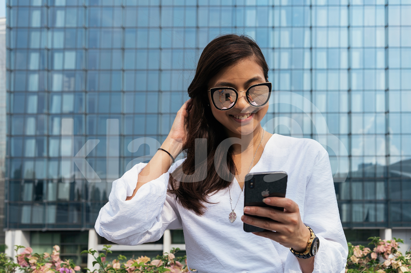Portrait of young beautiful woman using smartphone